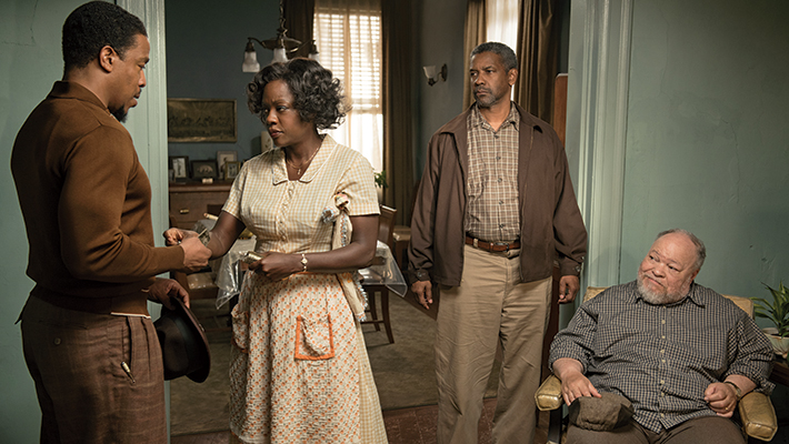 Russell Hornsby plays Lyons, Viola Davis plays Rose Maxson, Denzel Washington plays Troy Maxson and Stephen McKinley Henderson plays Jim Bono in Fences from Paramount Pictures. Directed by Denzel Washington from a screenplay by August Wilson.
